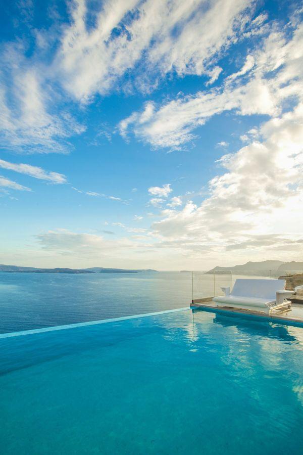 Bask in the endless views of the Aegean Sea at Santorini Secret Suites & Spa