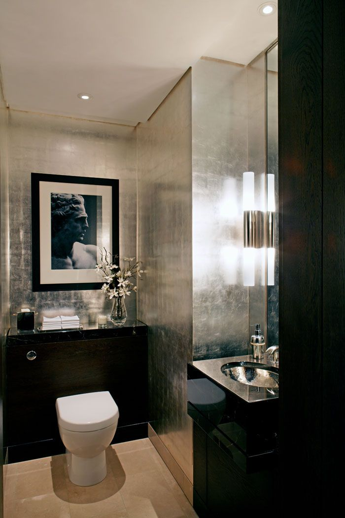 Hollywood glam with shiny shimmering walls and dark exotic woods, one great combo. One dramatic & sexy space. #bathroomsets #bathroomdecorideas www.alltherooms.com/JK