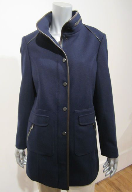 Schneiders Salzburg Womans FRANZISKA  Coat Style 42769 NAVY. A definite favorite for this fall!  The hint at an Austrian military jacket gives great structure, without any restrictive movement.  As usual Schneider's exceptional tailoring shines through with slightly padded shoulders accented by curved leather piping.  Real leather details at stand up collar, trim and pockets.  Hidden two-way zipper down front behind metal buttons with snap closures. Outstanding water and stain resistance.