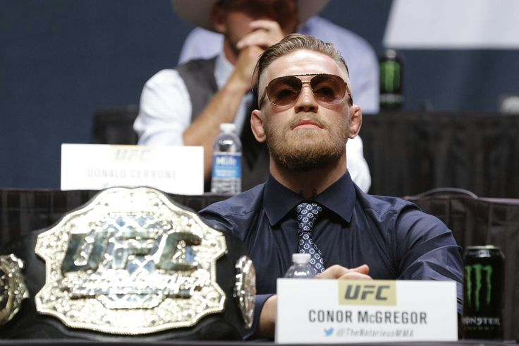 Morning Report: Conor McGregor says he will give up one of his belts after enjoying his 'historic moment' at UFC 205  Facebook.com/mmahwatch