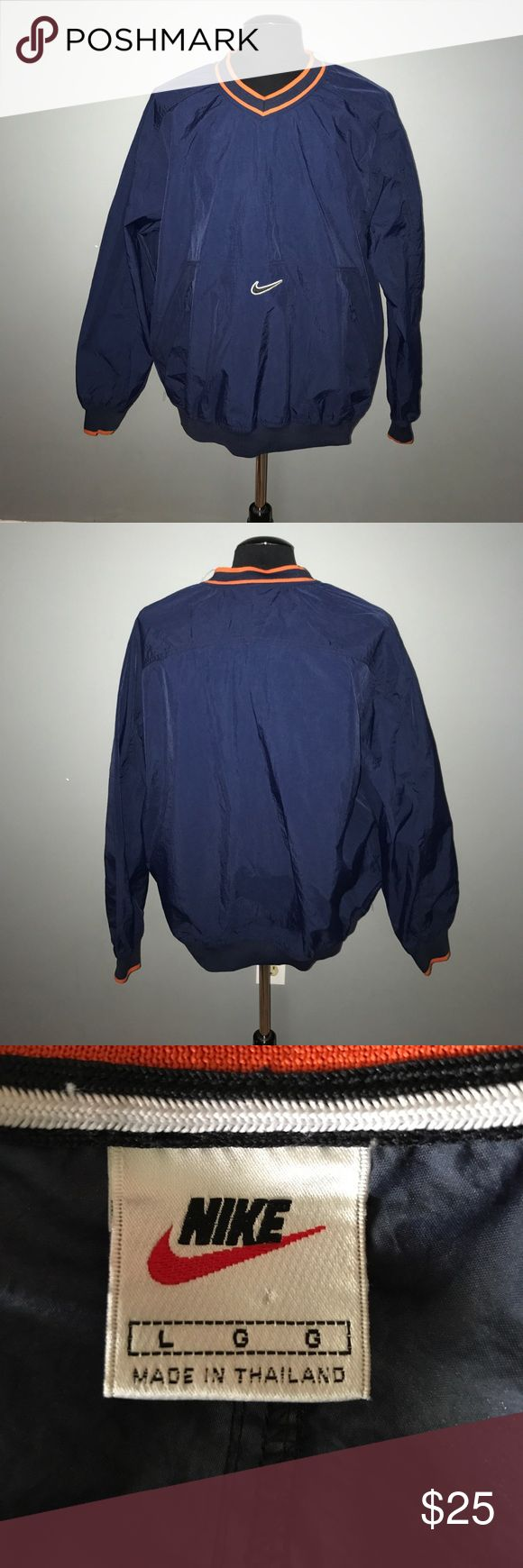 Nike Nylon Navy and Orange Pullover Excellent condition! 2 working zippered pockets in the front. Nike Jackets & Coats Performance Jackets