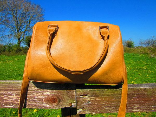 Tan Lady-like Handbag | Primark  Being lady-like is a tough sport these days. But if you need to attend formal meetings or show up in the office like a professional, use Primark's tan lady-like   handbag and nobody will doubt you for a second. The leather like material says it all. Great with pant suits and blazers.
