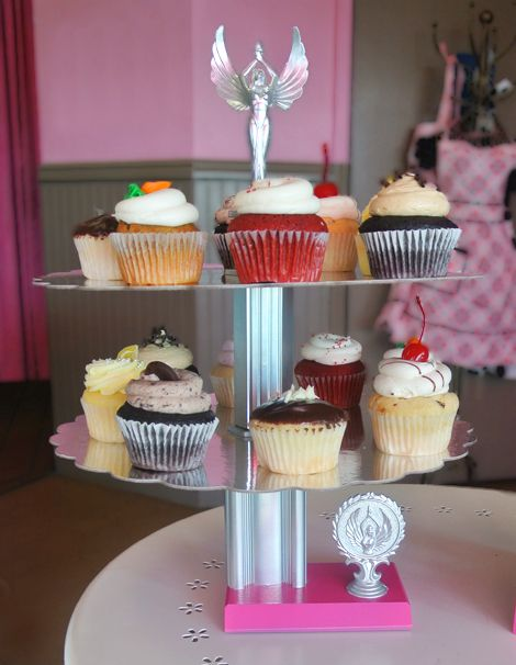 Cupcake stand made out of old trophies - great for sport theme birthdays / gymnastic birthdays / cheer party