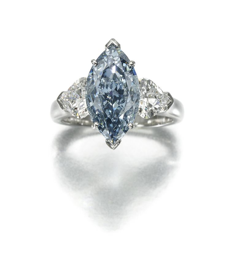 Fancy DIAMOND RING GRAFF Set at the centre with a fancy deep blue marquise shaped diamond weighing carats between heart shaped diamond shoulders