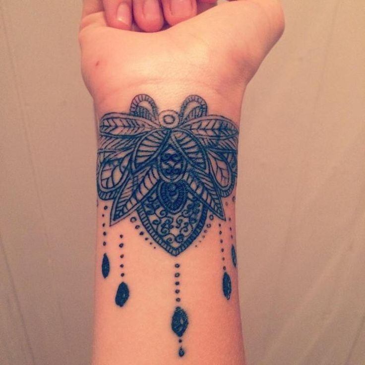 Beautiful traditional hands work wrist tattoo cover up