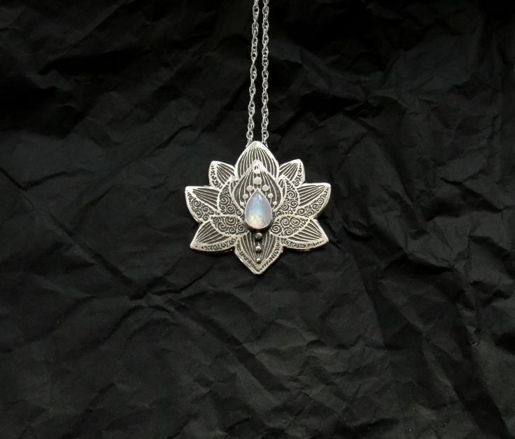 Lotus Pendant - Water Lily Necklace - Silver Flower Necklace - Moonstone Necklace - Heart Chakra Necklace by spaceweaver on Etsy https://www.etsy.com/listing/207989813/lotus-pendant-water-lily-necklace-silver