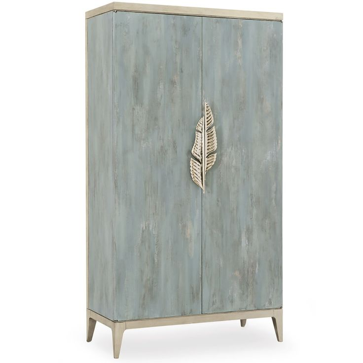 A piece of art is not always found on a canvas. Our custom-painted Watercolours cabinet is a piece of art that also solves a variety of functions in your home. Distinguished by its impressionistic Tranquil finish in greyish blue/aqua that has been kissed with silver leaf, it will literally shimmer in any room. In true Caracole style, our custom-designed, asymmetrical, metallic palm frond door pulls enhance this piece of art. Watercolours is sized to hold a 42-inch television. Additional…