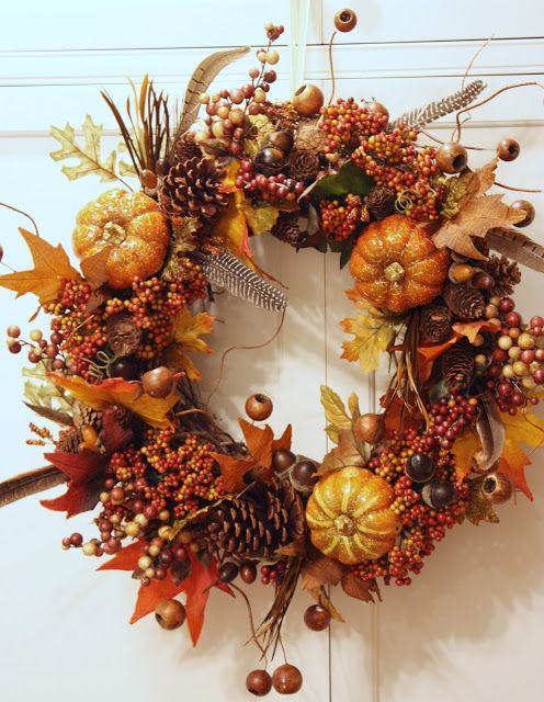 FALL PUMPKIN WREATH TUTORIAL - 2 grapevine wreaths, pumpkins, berries, crepe paper fall leaves, pine cones, acorns gourd pods, and feathers