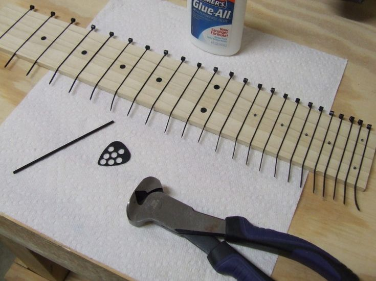 Cable tie frets - Cigar Box Nation