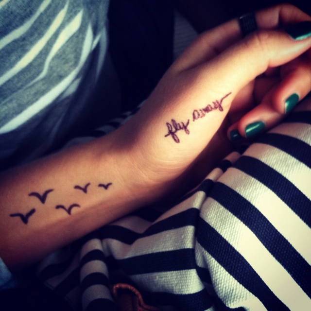 Fly away tattoo, maybe just the words on on side of finger...