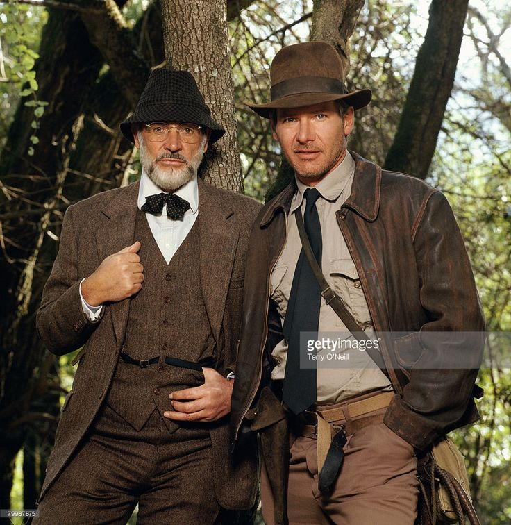 Sources for the costume: There is an interesting set of publicity shots done in front of a tree. Sean Connery's beard is lighter and groomed differently than in the film, and his tie is scrunched. Harrison Ford is wearing a long tie. This set of photos was probably taken in Marin County, California, during the shooting of the motorcycle chase sequence.  Dr Henry Jones Sr cosplay Indiana Jones and the Last Crusade