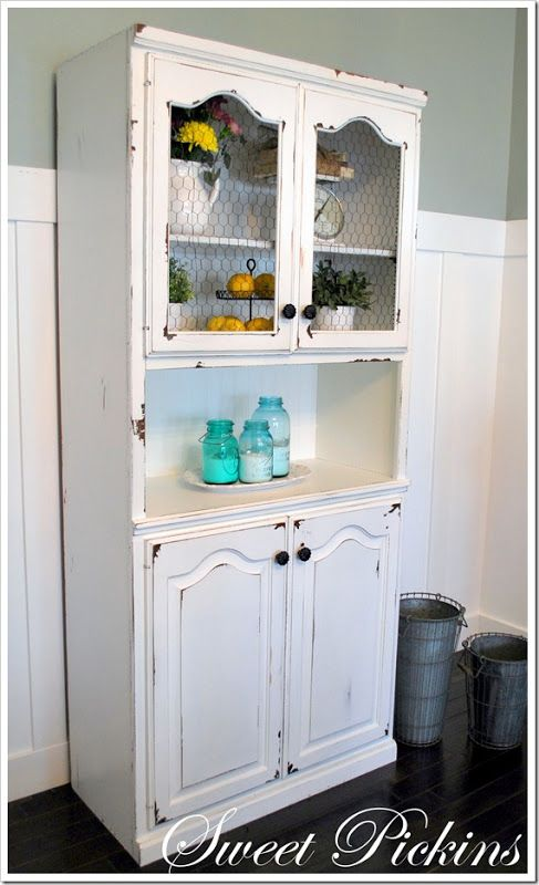 Using Vaseline to get a simple distressed and chippy paint finish like on this hutch with a farm house feel.
