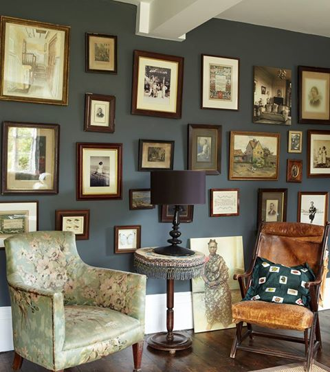 Old photos in old frames on Farrow & Ball blue