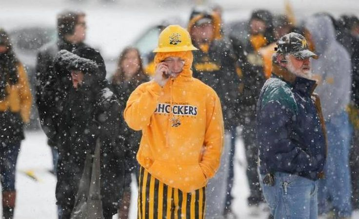 Wichita State fans wait in the snow to get inside Koch Arena for the College Gameday taping on Saturday.