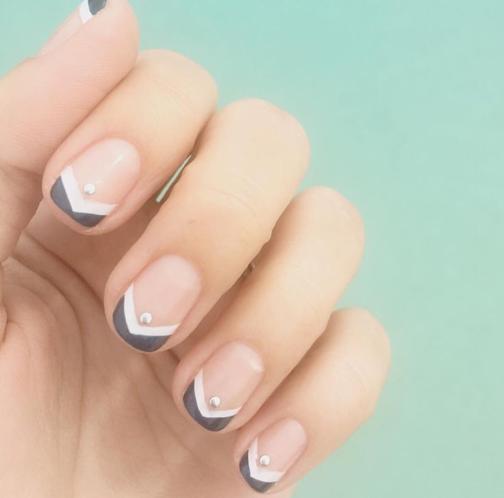 Gray and white chevron French manicure with gem