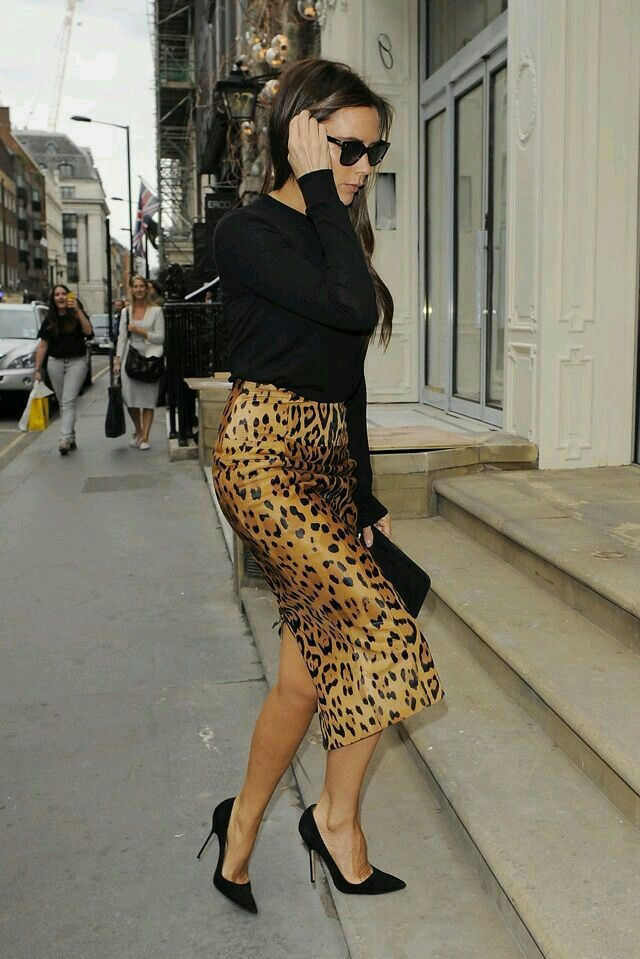 Black long sleeve shirt, cheetah skirt, black pumps, sunglasses, black bag