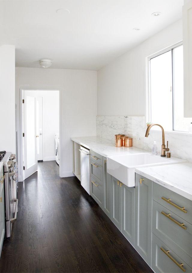 grey cabinets, wood floor