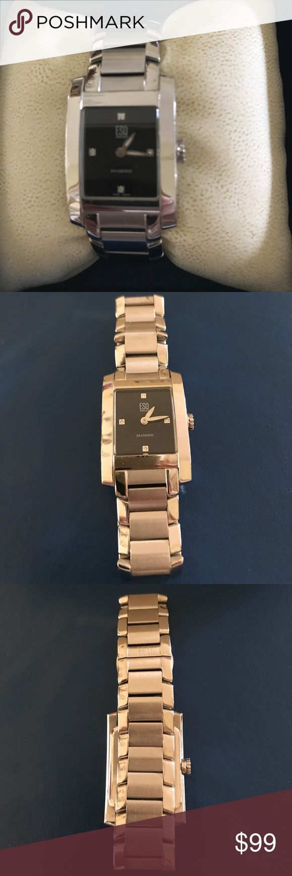 🔴💯ELEGANT ESQ WATCH. 🔴THIS BEAUTIFUL WATCH HAS A BLACK FACE WITH DIAMONDS ACCENTS ON THE 12, 3, 6 and 9. BRUSHED STAINLESS IN COMBINATION WITH GLOSSY STAINLESS. 6.5 CIRCUMFERENCE. COMES WITH BOX. BRAND NEW BATTERY.  SWISS MADE. SOME PHOTOS THE WATCH APPEAR GOLD TONE. IT IS SIVER TONE STAINLESS. ESQ Accessories Watches