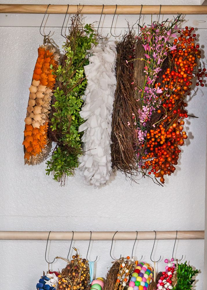 Hang your wreaths in a closet using DIY hooks.