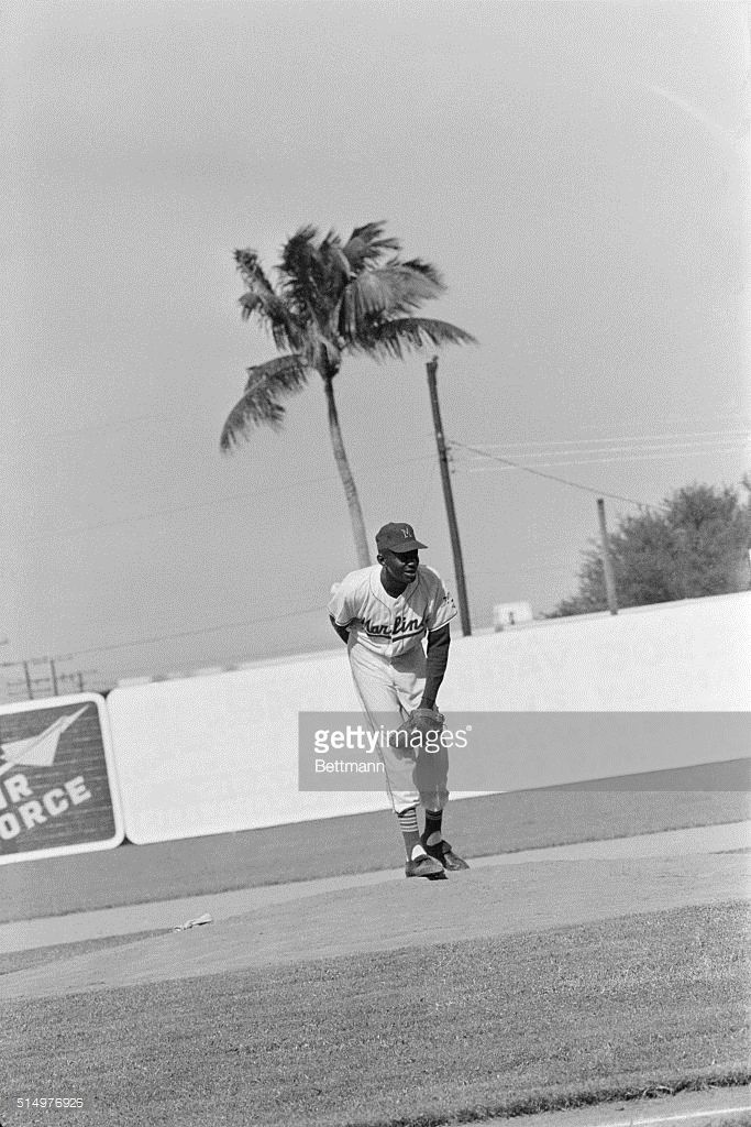 Miami, Florida: Just Keeps Pitching. Venerable hurler Satchel Paige, who some observers claim was present when Abner Doubleday invented baseball, is still going strong pitching for the Miami Marlins in the International League. Paige, who refuses to divulge his age, may be close to 60 years old. Here, Satch is shown in action during a game at Miami Stadium, August 3rd.