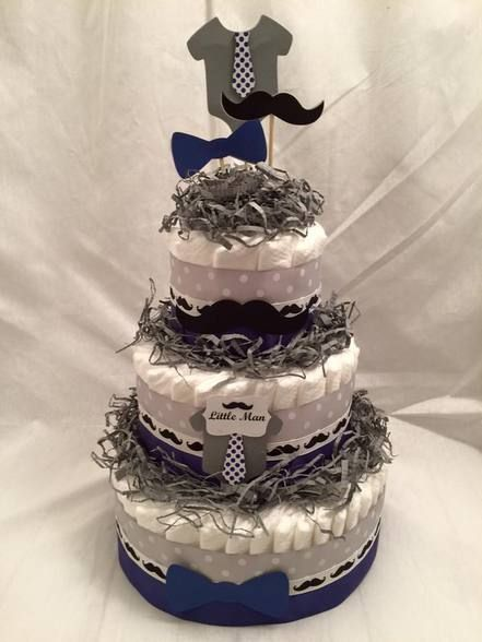 I make custom diaper cake centerpieces for your baby shower. My diaper cakes can also double as new baby gifts. I also make diaper bouquets, clothing bouquets, clothing cupcakes, diaper babies, diaper bikes, and much more.