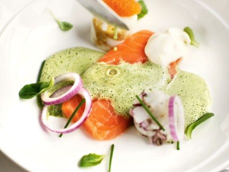 Raw salmon with chicken- and trufflebroth, eggs, kalix roe and scallop tartare