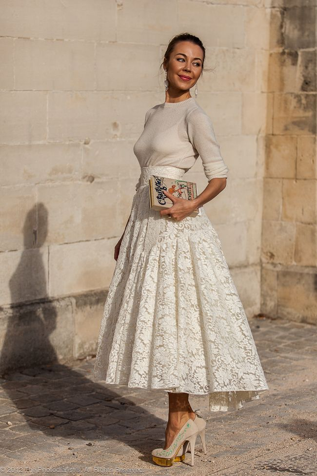 white lace skirt + blue-embroidered heels + olympia le-tan book clutch.   ulyana sergeenko.