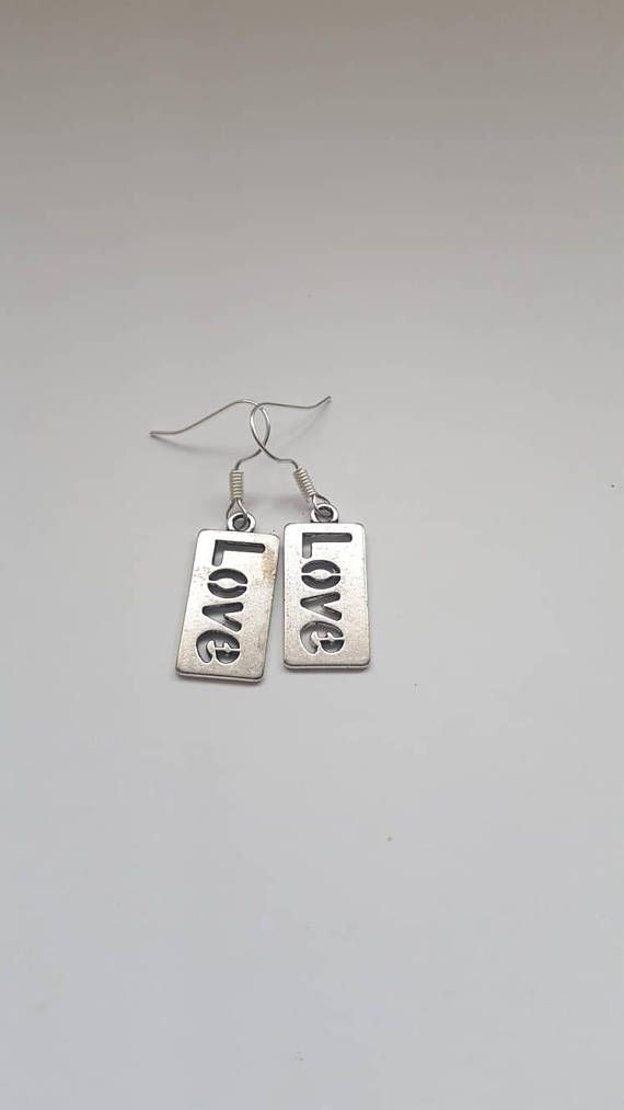 Check out this item in my Etsy shop https://www.etsy.com/uk/listing/542667248/silver-love-earrings-tibetan-silver