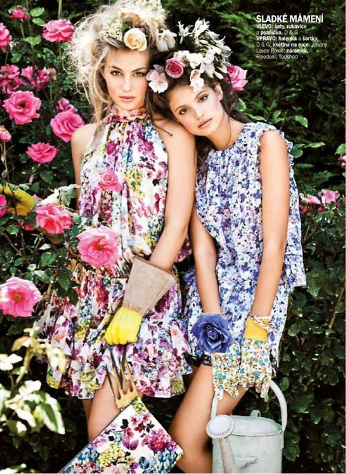 Two models with flower crowns and print dresses