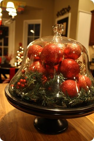 cake stand filled with ornaments & greenery ... cute dining room table centerpiece