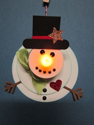 "Isn't he a happy fellow? Made from a flameless tealight candle, and 2 1/2 circle punch, and 3"" die cut. Hat is 1 inch square punch, and w..."