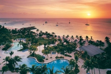 Radisson Aruba Resort, Casino & Spa Book your 2013 trip now and receive up to 40% off!  You'll receive up to 40% off room rates and the following bonus features:  $25 spa credit  $100 Casino Match-Play  $50 Resort Credit for stays of 4-5 nights  $100 Resort Credit for stays of 6 nights or more  For Details Contact http://taylormadetravel.agentarc.com  taylormadetravel142@gmail.com  call 828-475-6227