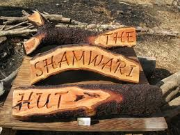 Company names carved on stumps