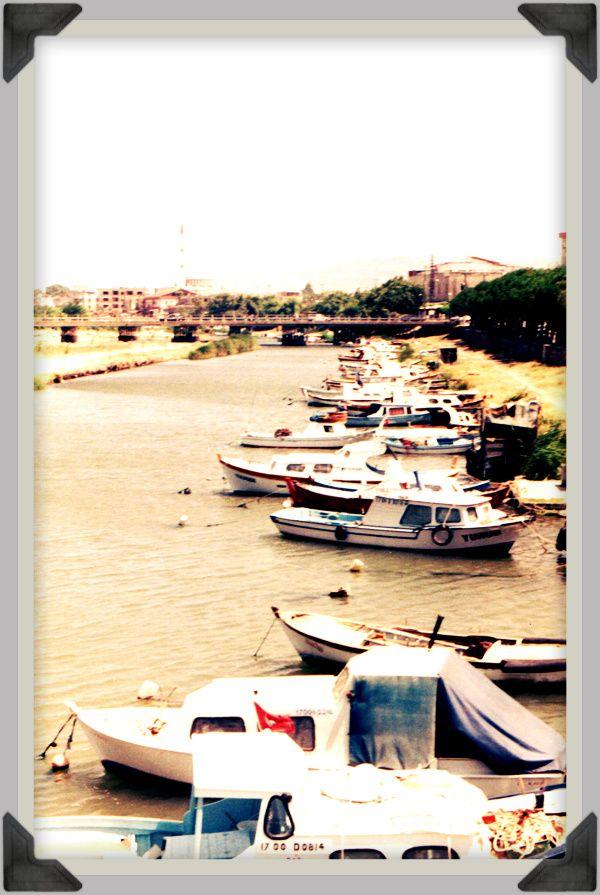 Dardanelles, Turkey. Fishing boats by the wooden bridge over Sarıçay, or Çanakkale creek.