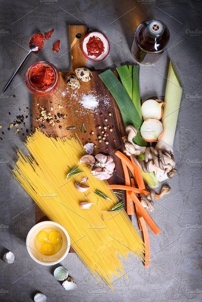 Raw pasta with tomato sauce by Iuliia Leonova on @creativemarket
