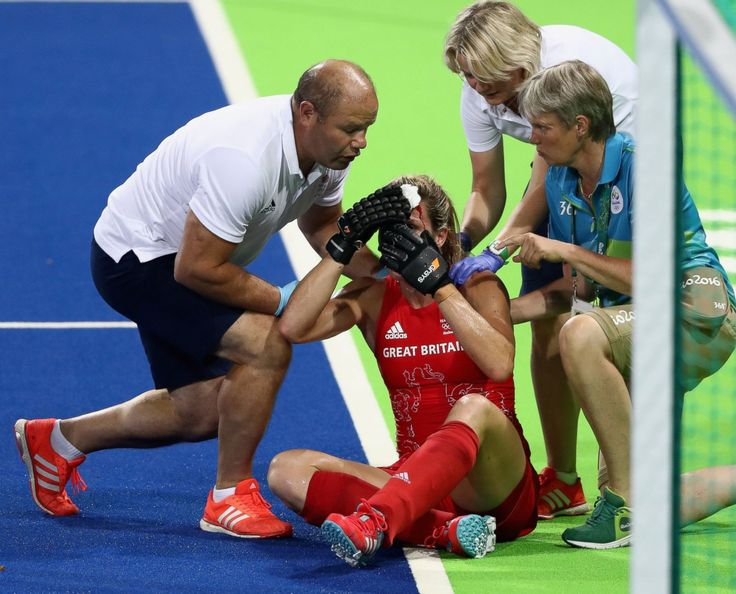 Crista Cullen of Great Britain receives attention after being hit in face during…