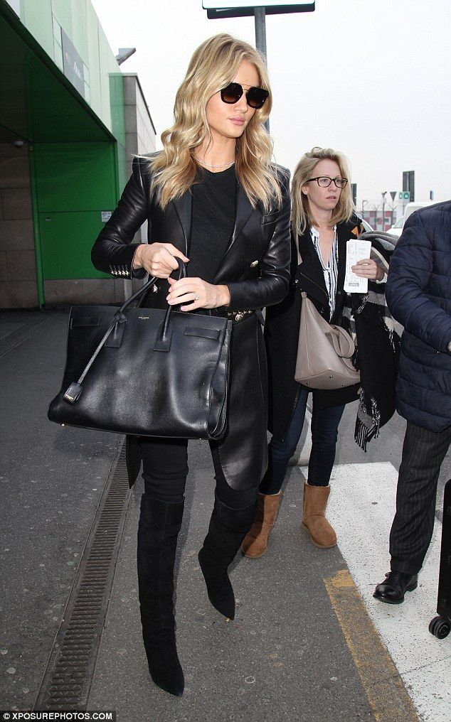 Woman in black: Clad in skin tight raven jeans, Jason Statham's soon to be wife had her toned pins lengthened with a stellar pair of knee high midnight boots