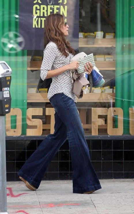 Wide legged jeans. The shirt and shoes keep it from looking baggy on her.
