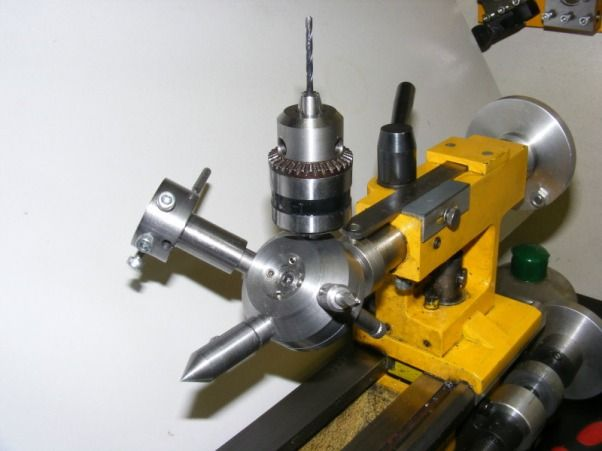 Tailstock Turret by mikesworkshop -- Homemade tailstock turret designed to accommodate four tools. Carries a rotating center, chuck, center drill, and die holder. Turret assembly consists of a taper, base plate, turret block, pivot pin, and detent assembly. http://www.homemadetools.net/homemade-tailstock-turret