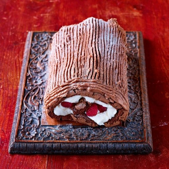 Paul Hollywood's Bûche de Noël ~ traditional French Christmas dessert of chocolate roulade filled with raspberry cream and coated in chocolate buttercream   via Woman and Home magazine