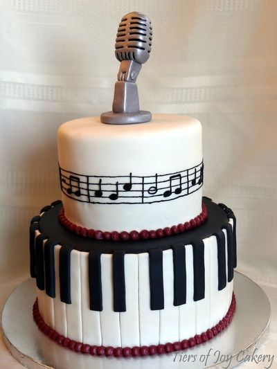 Music / keyboard cake with an old-style microphone made out of fondant.
