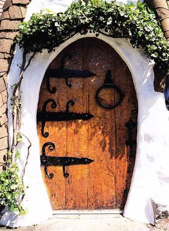 The handcrafted 300 pound front door with flame cut hammered hinges. The image of a Hobbit springs to mind.