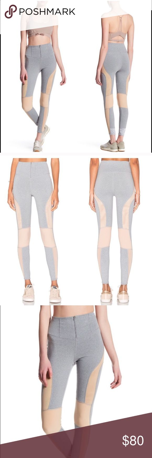 """Free People movement cool rider front zip leggings Moto-Inspired leggings take you from the studio to the streets with a cool zipper high waist, color-blocked panels and contoured power mesh insets that vent excess heat as you work out. Smooth flat-lock seams ensure a chafe-free fit against your skin. Soft and stretchy fit.                                                          •Front zip fly •Waistband stash pocket in the back             Approx. 11"""" rise, 26"""" inseam         88% nylon…"""