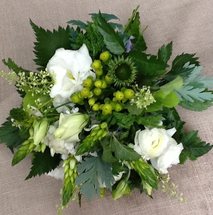 This is one of seven bouquets I made for someones wedding. All of the bridesmaid's bouquets were in white, but they all had different flowers with similar foliage. This bouquet had lisianthus, hypericum, star-of-bethlehem and heuchera flowers. The foliage includes astilbe,tansy, heuchera and immmature cone flowers.