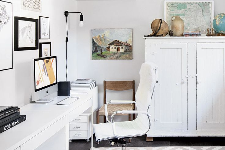 A carefully considered workspace decorated by avoiding office stores—Boasting a serene envelope, layers of time-worn character and methodically organized supplies, this fully renovated home office works all the angles.