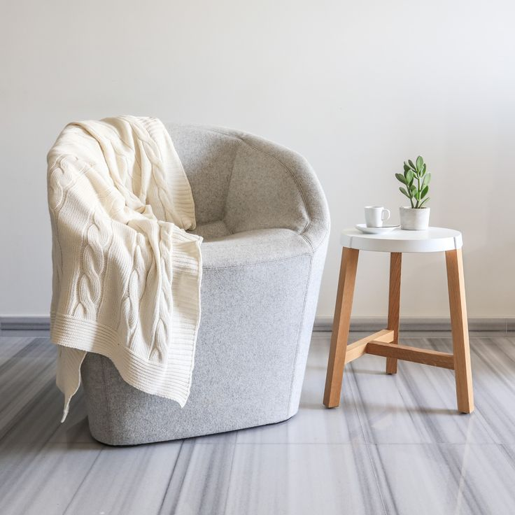 Blom chair's unique shape is a lovely addition to your living environment.