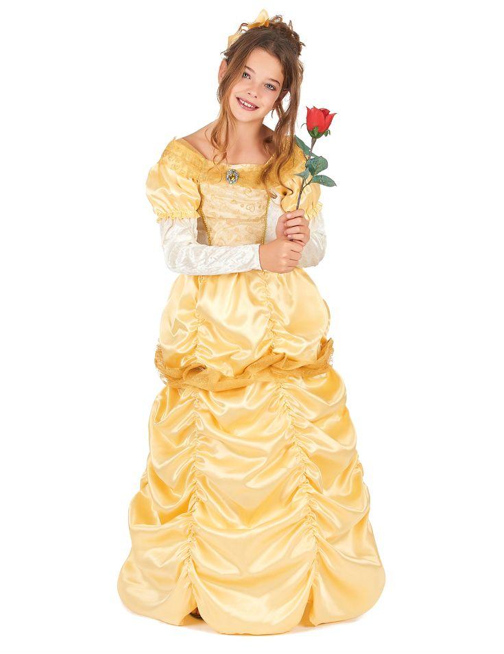 Disfraz princesa bella niña: Este disfraz de princesa para niña incluye un vestido y una tiara. El vestido en tonos dorados, tiene mangas largas con hombros ahuecados. El pecho está adornado con corazones...