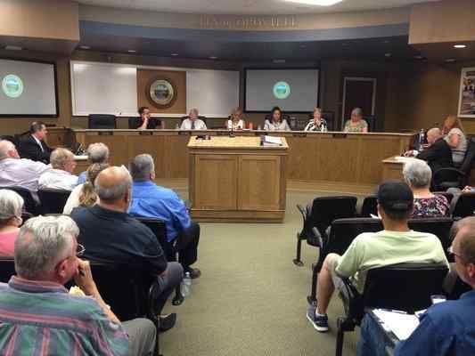 The Oroville City Council considers exiting from the settlement agreement at a special meeting on Tuesday. The former mayor signed the contract with over 50 other entities in 2006, promised over $61 million for recreational projects in the city. Still waiting to receive a license for the dam today, the city has not seen much of that money over the years, getting $100,000 annually in the interim. (Risa Johnson — Mercury-Register)