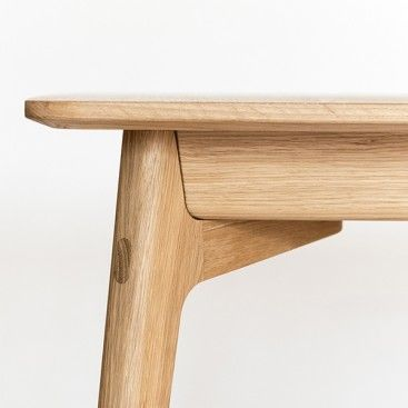 Rounded legs and table top are joined with master craftsmanship.