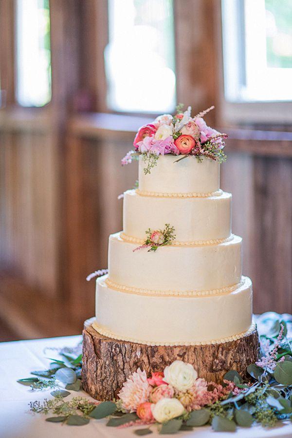 A Romantic Pastel Wedding Cake On A Tree Stump J Harper Photography Elegant